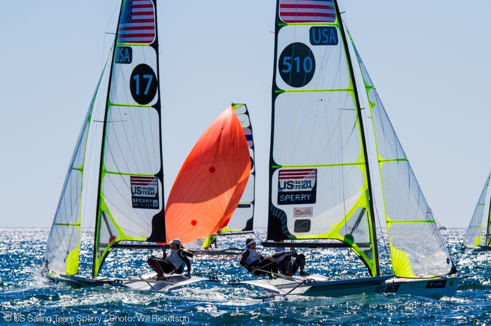 Because a sailboat can't sail directly into the wind, teams sail on starboard tack (boat at left) or port tack (right) and zig zag their way upwind. Lightweight skiffs such as the 49er (shown) also zig zag when sailing with the wind (e.g. red sail); the boats gain so much speed that they more than make up for the extra distance covered. Photo US Sailing Team Sperry/Will Ricketson.