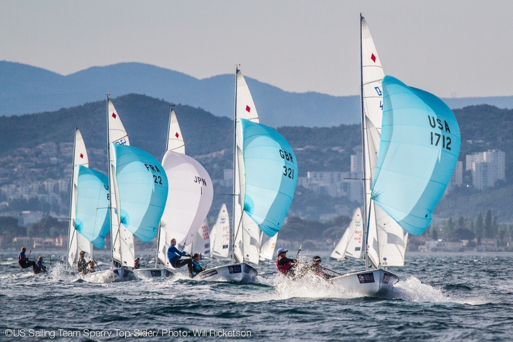 Women's 470 team Annie Haeger and Brianna Provancha lead an international fleet of 470 dinghies flying spinnakers downwind. Photo: Will Ricketson.