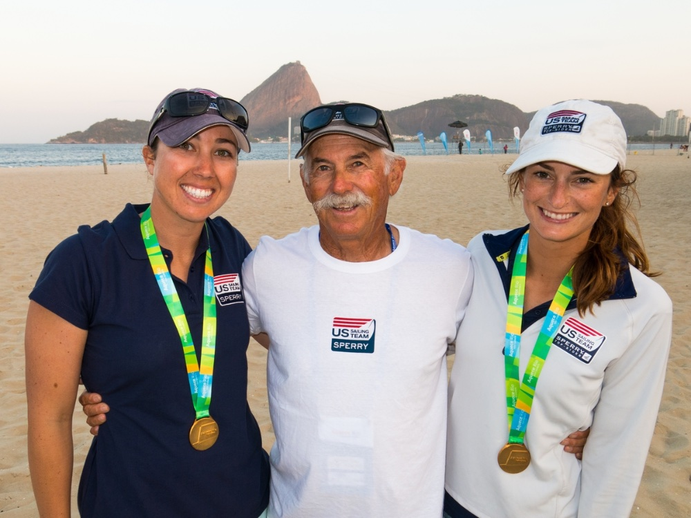Brianna Provancha (left) and Annie Haeger will compete in the 470 Women's event; shown with their coach Dave Ullman (a three-time 470 world champ himself). Photo: Will Ricketson.