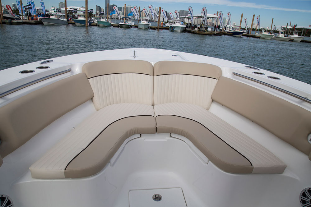 Twin pop-out backrests that stow flush under the gunwale can turn the starboard and port sides of the bow seating into forward-facing lounges.