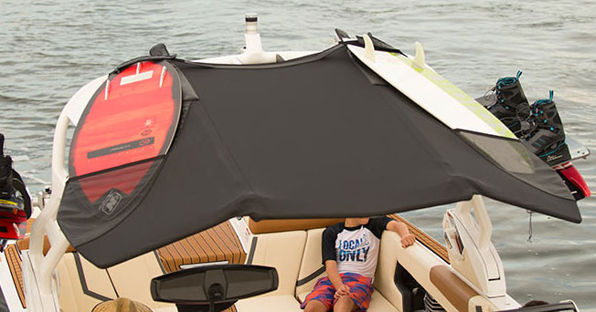 Where will you stow those surf boards? Not a problem, with the new Bimini top offered by Nautique.