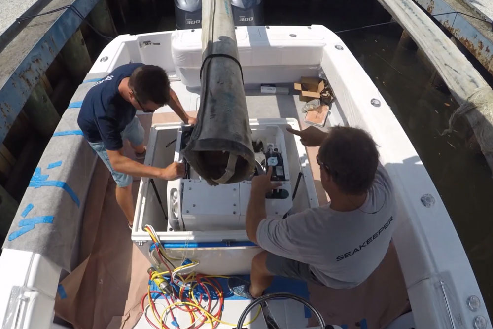 A Seakeeper 3DC gets lowered into a leaning post, for installation in a 32' center console. As you can see, the installers take great pains to ensure that the boat is well-protected and once the job is complete, just by looking it will be virtually impossible to tell the Seakeeper has been installed.