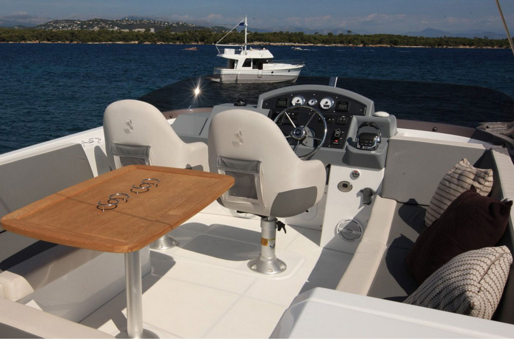 The flybridge is accessed via a set of teak steps from the aft cockpit, and is roomier than one might expect.
