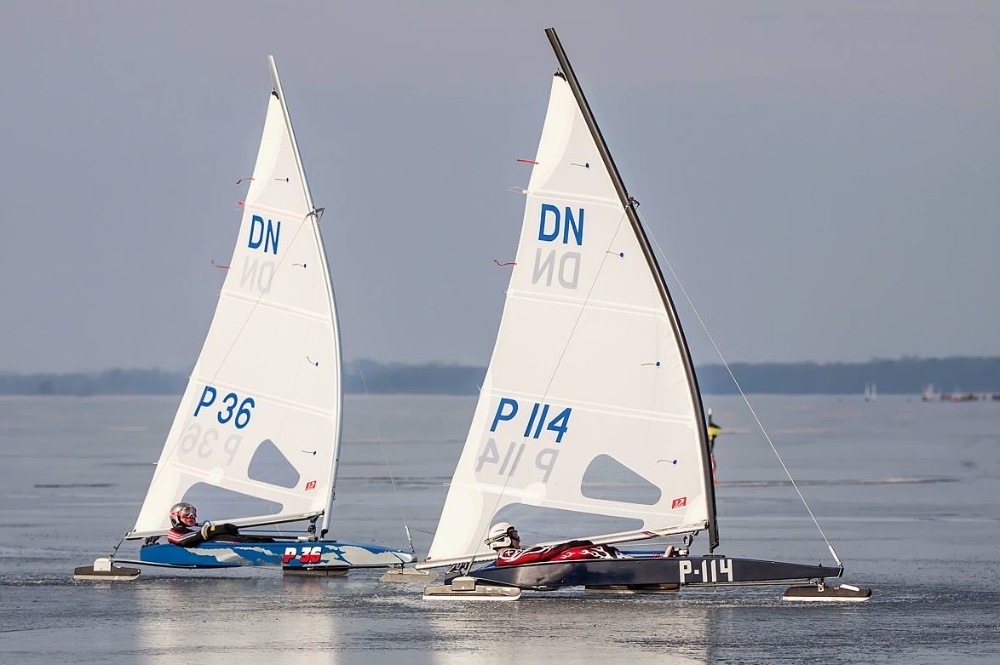"DN iceboats sail across a frozen lake at high speeds; these 12-foot long, one-person ""boats"" race as an international class in Europe and North America."