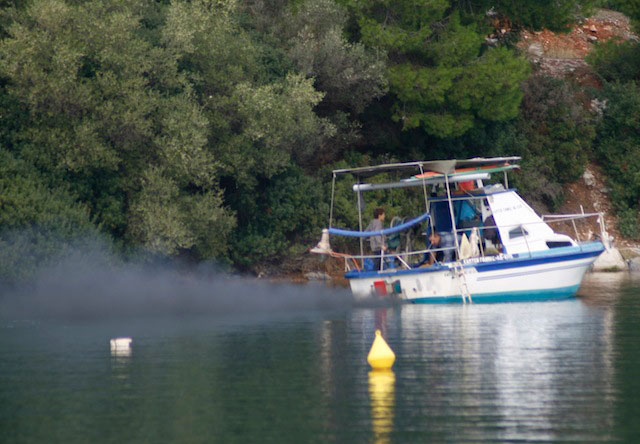 This boat has a bad case of black smoke, a sure sign of excess, partially combusted fuel. It may take some detective work to figure out the cause.