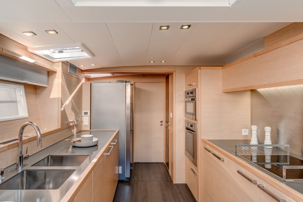 A full-sized refrigerator and oven and a double sink are a few of the perks chefs will enjoy, thanks to the spaciousness of the galley in the 630 Motor Yacht.