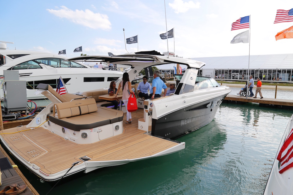 The new Sea Ray SLX 400 features a drop-down topside panel that forms a unique teak island. Gary Reich photo.