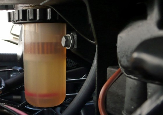 An engine-side canister with a filter and a water sump is the last line of defense before water works its way into the engine.
