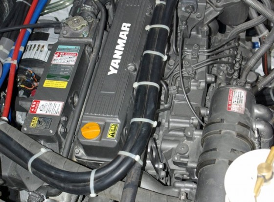 The nylon tie-wraps holding hoses on top of this Yanmar diesel won't last long in the heat of the engine compartment.