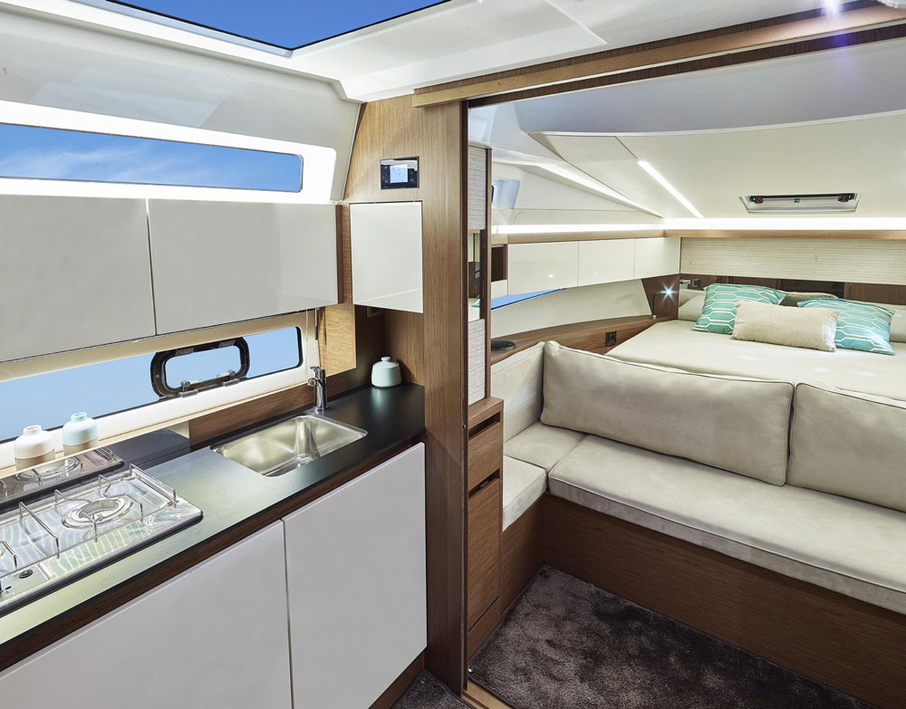 With the forward cabin doors open, the galley, settee, and forward stateroom enjoy social integration.