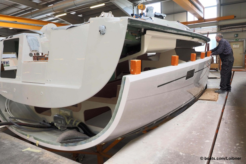 Once the interior is completely installed the deck is fitted to Hanse's sailing yachts. Photo by Dieter Loibner.