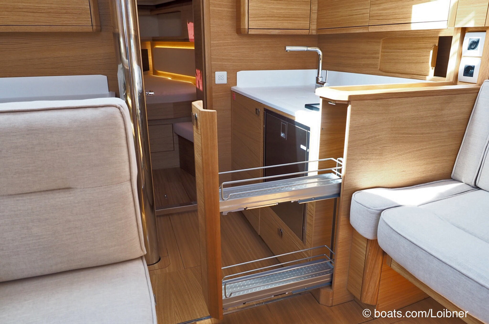 The forward galley athwartships offers additional storage cabinets on the starboard side.