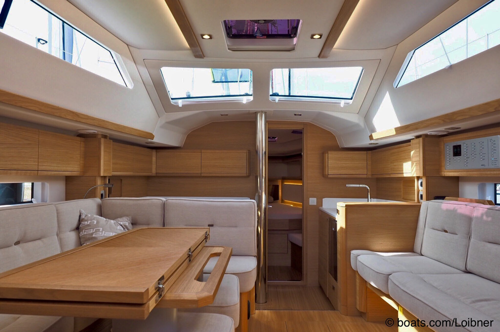Bright upholstery and lots of natural light create a bright atmosphere in the deck saloon.