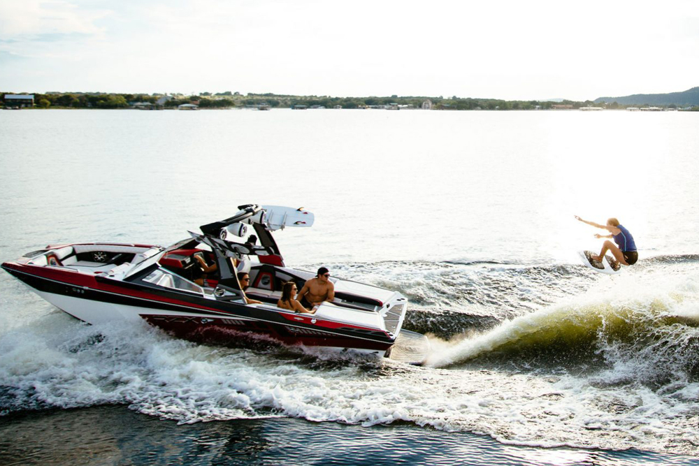 Though it's smaller and less expensive than many dedicated watersports boats, the RZX3 is ready for some serious wake surfing action.