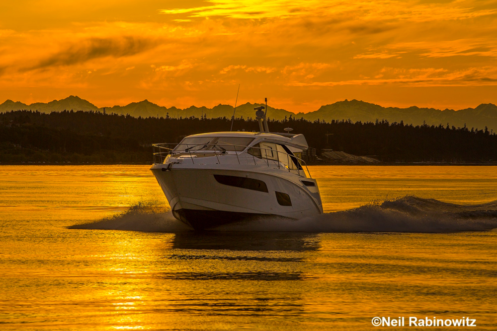 This Sea Ray Sundancer 460 is on its way to an owner's rendezvous, with the Olympic Mountains as a backdrop.