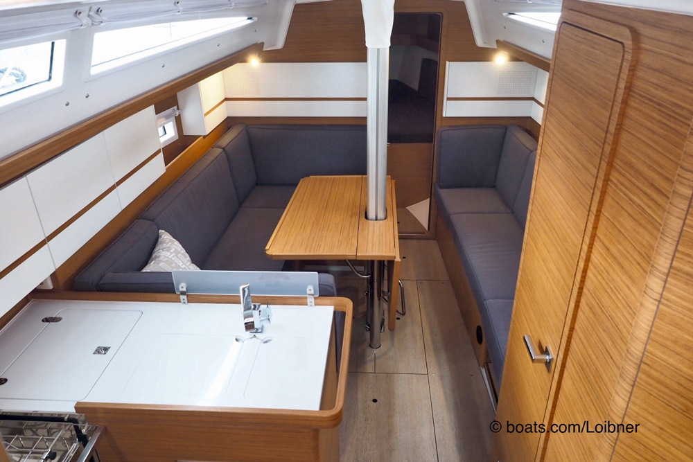 The keel-stepped mast required a creative solution with a saloon table that has two fold-down leaves, but it also provides a practical place to hold on when moving about this part of the cabin when at sea.