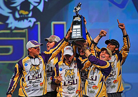 The LSU anglers celebrate on stage, at the Bassmaster Classic.