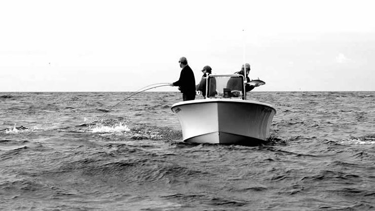 A photo of a Cape Fisherman 23 working a school of false albacore off Cape Lookout, NC.