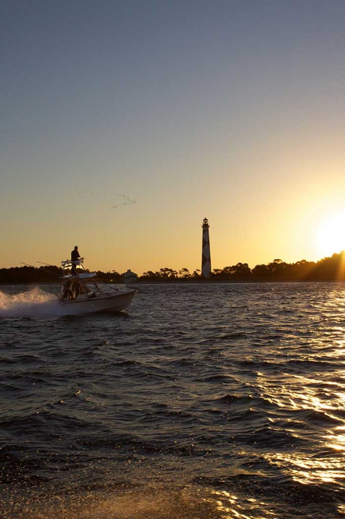 A captain speeds past the Cape Lookout Lighthouse at sunrise with a flock of ducks as a backdrop on his way to find the big ones. The photo was taken as part of a story I wrote for a local powerboating magazine on the false albacore fishing run that happens there every year. Photo: Gary Reich