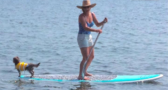 Kim Ferguson and Gilbert on SUP