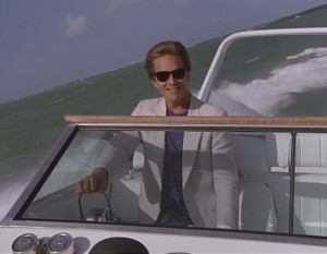 A picture of Sonny Crockett driving a boat.