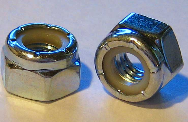 A photo of a pair of stainless steel nylon lock nuts.