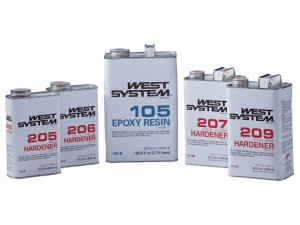 A photo of cans of West System epoxy resin.