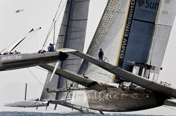 In this photo, USA has gained and is flying its center hull consistently. It will soon overtake the defender, Alinghi 5. BMW Oracle/Gilles Martin Raget photo