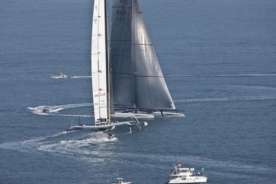 Forced by the right-of-way USA (foreground), Alinghi begins to tack, but USA is about to turn right to avoid a collision, for which Alinghi was penalized. BMW Oracle/Gilles Martin Raget photo