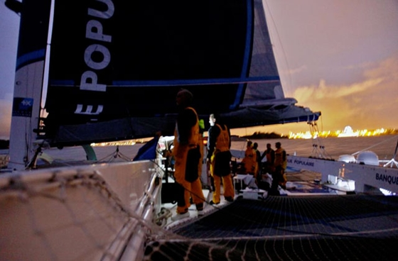 <i>Banque Populaire V</i> crosses the finish line, breaking the world circumnavigation record. Photo courtesy of BPCE.
