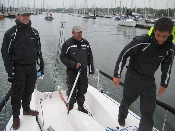 Heading down the Hamble River at 0600, Sam, Ian, and Dan (left to right)