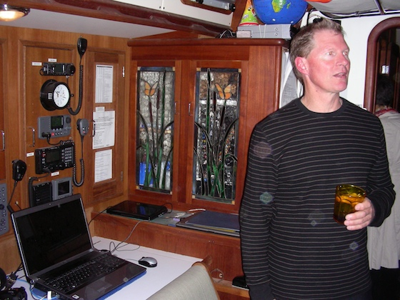 Adventure photographer Dave Thoreson, shown in the Ocean Watch main saloon, has now transited the Northwest Passage twice on a sailboat.