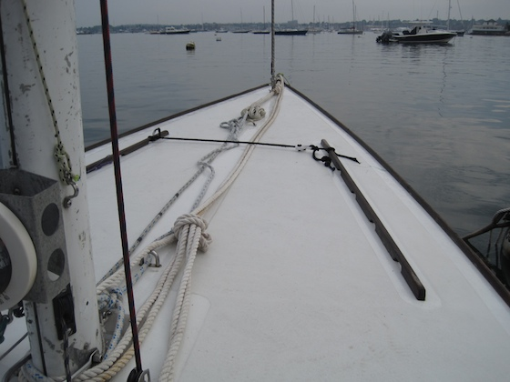 A doubled-up line leads from the mast to the mooring chain, backing up the mooring pennant. Another backup line leads from mast to pennant loop in case the cleat pulls out of the deck.