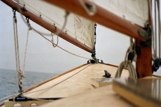 Between the boom and the coaming, the view forward from aboard the author's Herreshoff Marlin