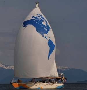 The 64-foot Ocean Watch flies a spinnaker showing the Americas, the bulk of which she has sailed around in the last year