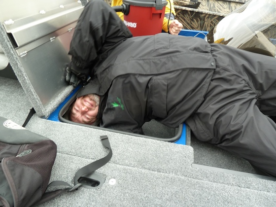 Boats.com reviewers go all out when they test a boat such as this Crestliner VT17. This storage space was big, but Charles couldn't quite climb inside.