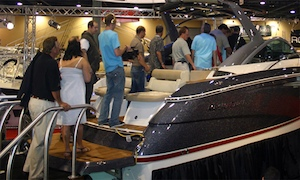 Visitors and journalists troop aboard the new 300 at the 2009 Miami International Boat Show.