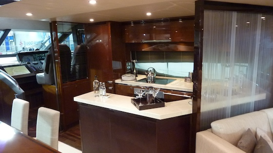 Amidships, the galley is just aft of the helm and immediately adjacent to the dining area.