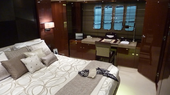 The master berth sits on centerline with writing desk to port and seating to starboard.
