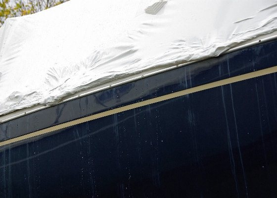 When shrink-wrapping a hull painted with Awlgrip, it's best to follow this example, and not cover the paint.