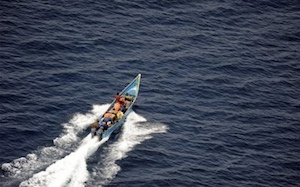 Suspected Somali pirates fleeing the scene.