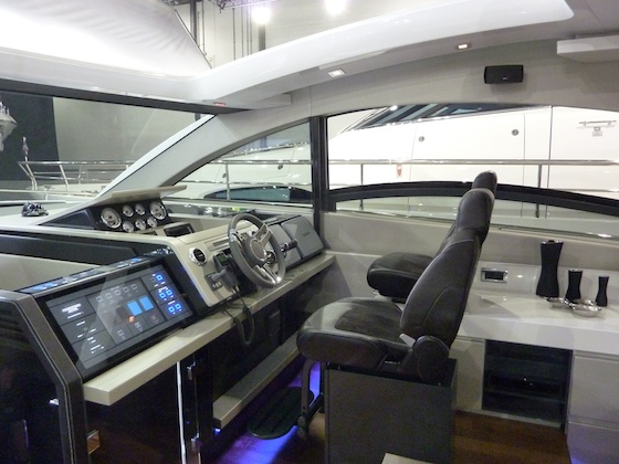 The helm station offers control and fresh air. Note the front of the 3-meter starboard side window in retracted position.