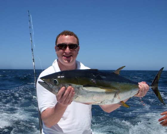 Adam shows off his yellowfin tuna.