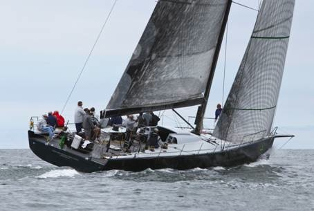 Demonstrating the typical wide, flat transom, plumb bow and bow sprit of modern IRC boats, Vanquish sails upwind in a light breeze off Newport, Rhode Island. Dan Nerney/NYYC photo