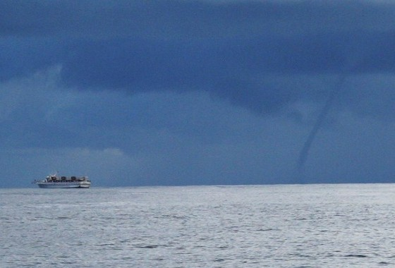 A sight like this waterspout, shooting down from a squall, means you could be in for a severe storm experience.