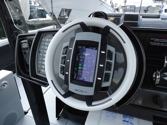 On the Wider 42, gauge functions are displayed on a touch-screen display embedded in the steering wheel.