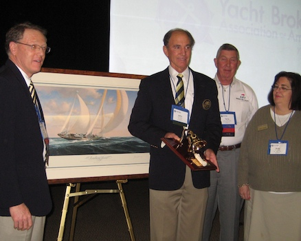 John Weller receives first Paul Bennett award, including a John McCray print, from Bill Full (left) and other members of the selection committee, Terry Rose and Sally Helme.